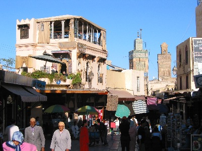 Market, restaurant, and minarets in Fès